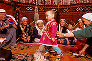 Kazakh mothers and toddler's first step ritual, Kazakhstan