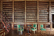 Emperor Library, Castle of Compiegne, Oise, France. The walnut and gilded wood bookcases and walls were made by Jacob-Desmalter in 1808. A secret door, hidden behind false books, lead to the Empress's apartment. The castle was built in the 18th century in neoclassical style as the Royal residence for the French King Louis XV. It was destroyed during the French Revolution and later restored at the begining of 19th century by Napoléon in First French Emperor style with Louis-Martin Berthault as main architect. Picture by Manuel Cohen