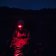 STERLING, VA - JUN13: Bethany Gregory, a field technician with GAI Consultants, covered to protect from mosquitos and ticks, waits in a dark field to  check mist nets for bats every 15 minutes, July 13, 2015, during a bat census to make sure the planned Silver Line train yard near Dulles Airport doesn't impact the bats living in the woods near the site. Fine 'mist nets' are hung from polls to capture bats and determine whether there is a threatened bat species in the area. The bats are then released. (Photo by Evelyn Hockstein/For The Washington Post)