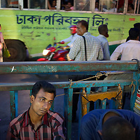 Market traders and busy traffic during evening rush hour in Dhaka.     <br /> <br /> Photo: Tom Pietrasik<br /> Dhaka, Bangladesh<br /> November 9th 2014