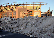 A pile of snow in the parking lot frames the foreground as Lincoln Financial Field stands tall in the late day sun before the Philadelphia Eagles NFL NFC Wild Card football game against the New Orleans Saints on Saturday, Jan. 4, 2014 in Philadelphia. ©Paul Anthony Spinelli