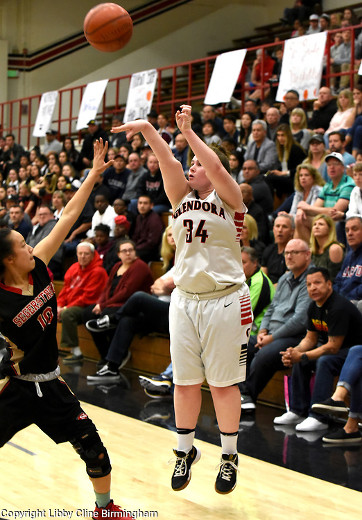 Glendora's McKayla Tilton (34) takes a three point shot in the first half of a second round CIF girls basketball game against Segerstrom  at Glendora High School in Glendora, Calif., on Saturday, Feb. 17, 2018. (Photo by Libby Cline Birmingham)