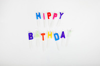 Birthday candles over white background