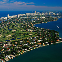 Aerial of La Gorce Golf Course on Miami Beach looking south to South Beach with Biscayne Bay and the Atlantic Ocean.