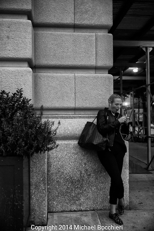 NEW YORK, NY - October 28:  A woman on her phone on October 28, 2014 in NEW YORK, NY.  (Photo by Michael Bocchieri/Bocchieri Archive)