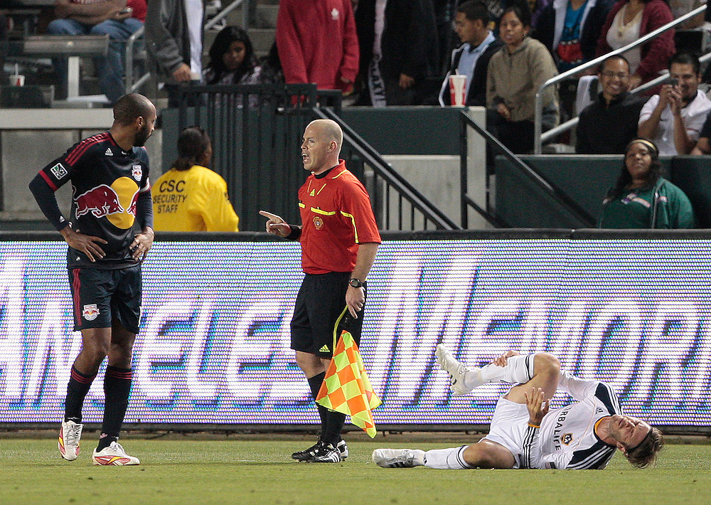 Referee's assistant Mike Kampmeinert, center, speaks to New York Red Bulls forward Thierry Henry, left, of France after Los Angeles Galaxy midfielder David Beckham of England is fouled in the first half of a MLS soccer match, Saturday, May 7, 2011, in Carson, Calif. (AP Photo/Jason Redmond)