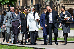 © Licensed to London News Pictures. 10/05/2018. London, UK. Fatima Boudchar (centre, in white) arrives on College Green outside Parliament to speak to the media after Attorney General Jeremy Wright announced that a settlement had been reached over her 2004 rendition to Libya. Fatima Boudchar and her husband, Abdel Hakim Belhaj, were kidnapped in Thailand in 2004 and flown to Libya in a rendition operation, allegedly with the help of MI6. Photo credit: Rob Pinney/LNP