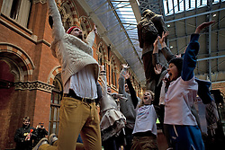 © Licensed to London News Pictures. 20/01/2012. London, U.K..Lorna Tullet and Bryan Tullet, Sanderson Jones and Mikey Lear, Emily Brown and Rose Manley and Jeanette (Xiang Xu) were the last Four couples remaining in the Final minutes of the record breaking world's Longest marathon hug attempt at St. Pancras station, London. To celebrate National Hugging Day (21 January) and to signal welcoming the world to London in 2012, London breaks the Guinness World Records title for the world's Longest marathon hug..Photo credit : Rich Bowen/LNP