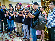 26 NOVEMBER 2017 - YANGON, MYANMAR: Journalists from Myanmar photograph Myanmar Catholic Bishops at a press event in Yangon Sunday. The Bishops were talking about the visit of Pope Francis to Myanmar. The Pope will visit Yangon November 27 - 30. He will have private meetings  with government officials, military leaders and Buddhist clergy. He will also participate in two masses, a public mass in a sports complex on November 29 and a mass for Myanmar youth in St. Mary's Cathedral on November 30.    PHOTO BY JACK KURTZ