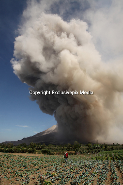 KARO, INDONESIA - JUNE 27: <br /> <br /> Eruption of Sinabung Mount Volcano in Indonesia<br /> <br /> A view of Sinabung mount eruption at Tiga Kicat village on June 27, 2015 in Karo regency, North Sumatra Province, Indonesia.<br /> Over 10,000 residents have been forced to evacuate preemptively over concerns of eruption from Mount Sinabung. The once dormant volcano has recently been observed displaying heightened activity.<br /> &copy;Ahmad Ridwan Nasution/Exclusivepix Media