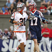 Brodie Merrill #17 of the Boston Cannons and Jeremy Sieverts #20 of the Denver Outlaws jostle for position during the game at Harvard Stadium on May 10, 2014 in Boston, Massachusetts. (Photo by Elan Kawesch)