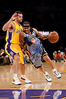 06 November 2009: Guard Allen Iverson of the Memphis Grizzles drives to the basket while being guarded by Jordan Farmar of the Los Angeles Lakers during the first half of the Lakers 114-98 victory over the Grizzles at the STAPLES Center in Los Angeles, CA.
