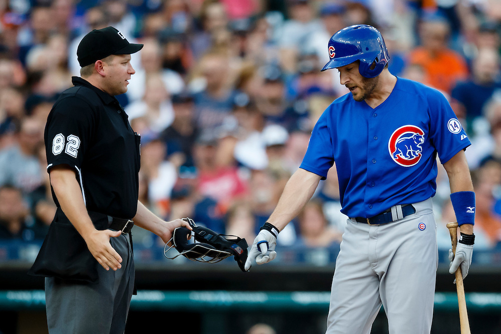 Jun 10, 2015; Detroit, MI, USA; Chicago Cubs right fielder Chris Denorfia (15) question a call by umpire Clint Fagan in the second inning against the Detroit Tigers at Comerica Park. Mandatory Credit: Rick Osentoski-USA TODAY Sports
