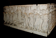 Roman Sarcophagus. Last decades of the 4th century. Detailed with a relief of crenelated towers, Christ and his followers, and Moses receiving the 10 commandments.