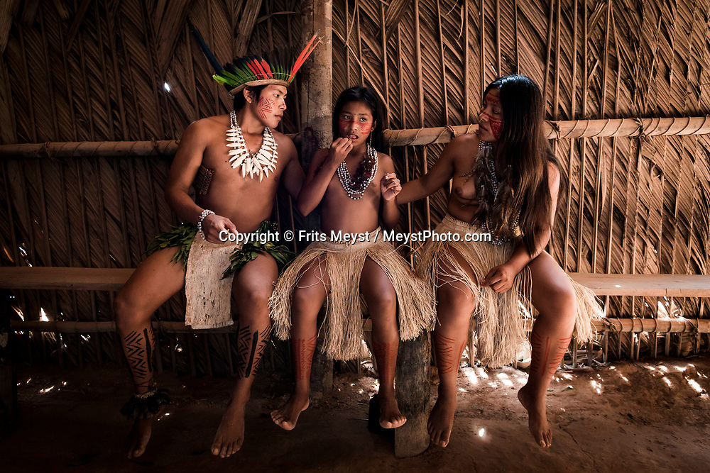 Manaus, Amazonia, Brazil, November 2018.  A few decades ago, a contingent of the Tucano tribe founded a settlement just 12 miles (20km) from Manaus in an tribe known as the Tucano. These people—whose ancestral home runs about 1,375 kilometers in length in the dense remote jungle of northwestern Brazil—migrated to the banks of the Uaupés River and its tributaries in the hopes of finding a better life as subsistence farmers and fishermen. As the years went by, the Tucano began benefiting from travelers who were curious to see their ancient traditions, but have shied away from mass tourism. The Amazone river and Rio Negro connect the small rain forest communities that dot the region. River Amazon (Portuguese: Rio Amazonas; Spanish: Río Amazonas) of South America is the largest river in the world by volume, with total river flow greater than all the other top ten largest rivers flowing into the ocean combined. The Amazon drains an area of some 6,915,000 square kilometres (2,670,000 sq mi), or some 40 percent of South America. Photo by Frits Meyst / MeystPhoto.com