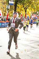 ING New York City Marathon: wearing suit and tie Brandon Weber runs in final quarter mile of race
