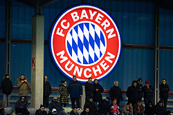 MUNICH, GERMANY - Wednesday, December 11, 2019: Supporters in front of an illuminated Bayern Munich logo before the final UEFA Youth League Group B match between FC Bayern München and Tottenham Hotspur at the FC Bayern Campus. (Pic by David Rawcliffe/Propaganda)