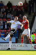 Walsall defender James O'Connor beats Crewe Alexandra midfielder Ryan Colclough to a header during the Sky Bet League 1 match between Walsall and Crewe Alexandra at the Banks's Stadium, Walsall, England on 26 September 2015. Photo by Alan Franklin.