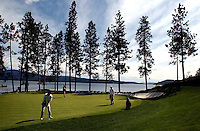 Players from Post Falls, Coeur d'Alene and Lake City High School close out the fifth hole Wednesday.