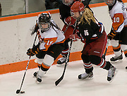 2012/03/04 - RIT's Kolbee McCrea skates around Plattsburgh's Teal Gove in the second period of the ECAC West Championship game between RIT and SUNY Plattsburgh at RIT's Ritter Arena on March 4th, 2012. RIT lead 2-1 after two periods of play.