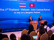 23 JULY 2015 - BANGKOK, THAILAND: NGUYEN TAN DUNG (left), Prime Minister of Vietnam,  and PRAYUTH CHAN-O-CHA, Prime Minister of Thailand, (right) make a joint statement about bilateral relations between Thailand and Vietnam at Government House in Bangkok. The Vietnamese Prime Minister and his wife came to Bangkok for the 3rd Thailand - Vietnam Joint Cabinet Retreat. The Thai and Vietnamese Prime Minister discussed issues of mutual interest.      PHOTO BY JACK KURTZ
