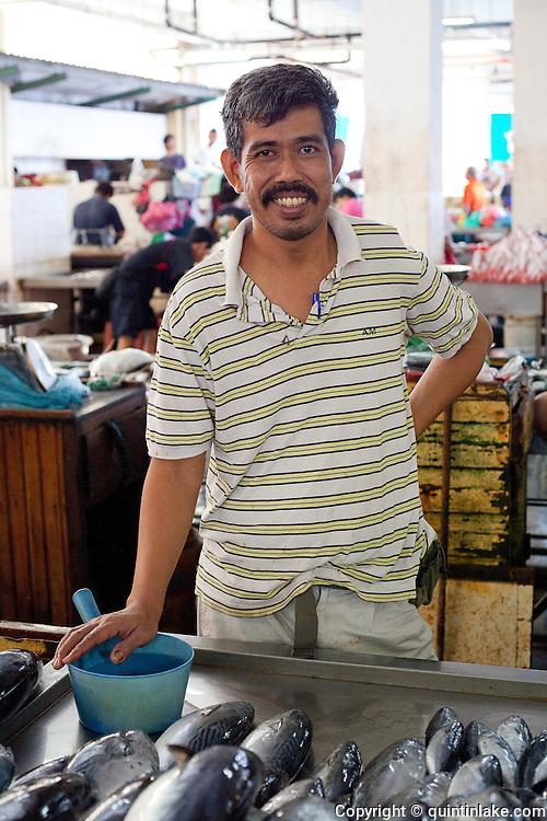 Man in the fish market in Sandakan, Sabah, Borneo