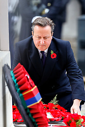 © Licensed to London News Pictures. 08/11/2015. London, UK. Prime Minister David Cameron laying a wreath on the Cenotaph during Remembrance Sunday ceremony in Whitehall, London on Sunday, 8 November 2015. Photo credit: Tolga Akmen/LNP