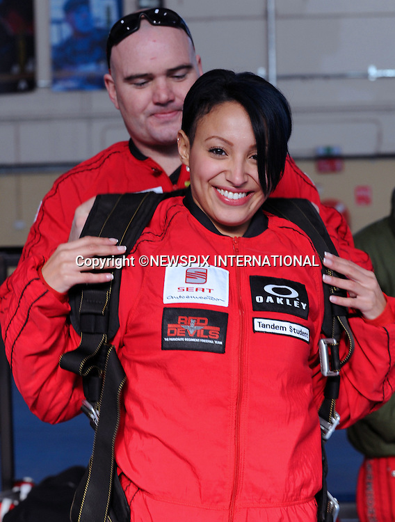 """AMELLE BERRABAH.with LCpl Nathan Connolly, Red Devils during her 13,000 feet charity tandem jump at Netheravon airfield..The Red Devils the Parachute Regiment and the British Army's official parachute display team ensured it was a """"sweet"""" experience for a Sugababes' first skydive. Amelle Berrabah, from the chart-topping pop group, did a tandem jump from more than 13 thousand feet and freefalled at 120 miles per hour above the skies in Wiltshire..""""I'd definately do it again, it was amazing and out of this world,"""" said the 25 year old Sugababe after landing safely in the sunshine at the Joint Services Parachute Centre in Netheravon. """"I panicked a bit at the exit door but Nathan my instructor was so good. All these guys are amazing they make you feel really calm.""""Amelle completed the jump in memory of my dad who died of cancer nearly eight years ago.  She hopes to raise as much money as possible for the charity Cancer Research UK_09/03/2010.Mandatory Photo Credit: ©Harmer/Newspix International..**ALL FEES PAYABLE TO: """"NEWSPIX INTERNATIONAL""""**..PHOTO CREDIT MANDATORY!!: NEWSPIX INTERNATIONAL(Failure to credit will incur a surcharge of 100% of reproduction fees)..IMMEDIATE CONFIRMATION OF USAGE REQUIRED:.Newspix International, 31 Chinnery Hill, Bishop's Stortford, ENGLAND CM23 3PS.Tel:+441279 324672  ; Fax: +441279656877.Mobile:  0777568 1153.e-mail: info@newspixinternational.co.uk"""