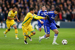Diego Costa of Chelsea is challenged by Cedric Soares of Sporting - Photo mandatory by-line: Rogan Thomson/JMP - 07966 386802 - 10/12/2014 - SPORT - FOOTBALL - London, England - Stamford Bridge - Sporting Clube de Portugal - UEFA Champions League Group G.