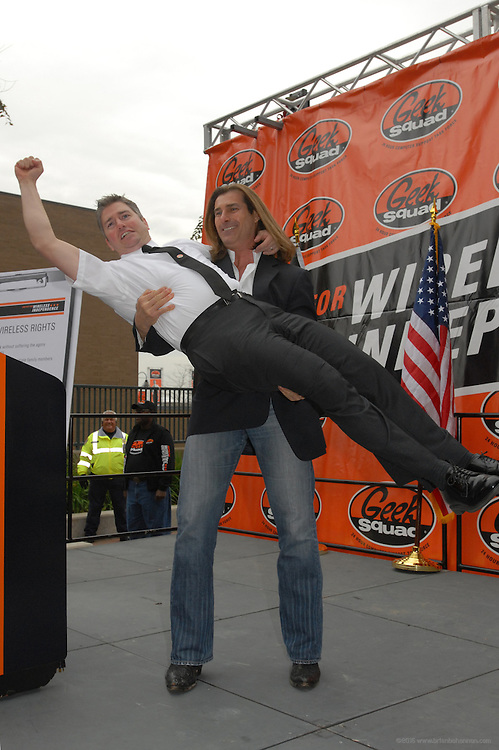 PHOTO PROVIDED BY GEEK SQUAD--In a gesture to show that geeks and jocks have united to promote wireless independence, model Fabio lifts Geek Squad  founder and chief inspector Robert Stephens into the air Wednesday, Oct. 25, 2006, as they announce a new Wireless Bill of Rights from Geek Squad during an event in Louisville, Ky., to celebrate the opening of Geek Squad City. (Geek Squad/Brian Bohannon)