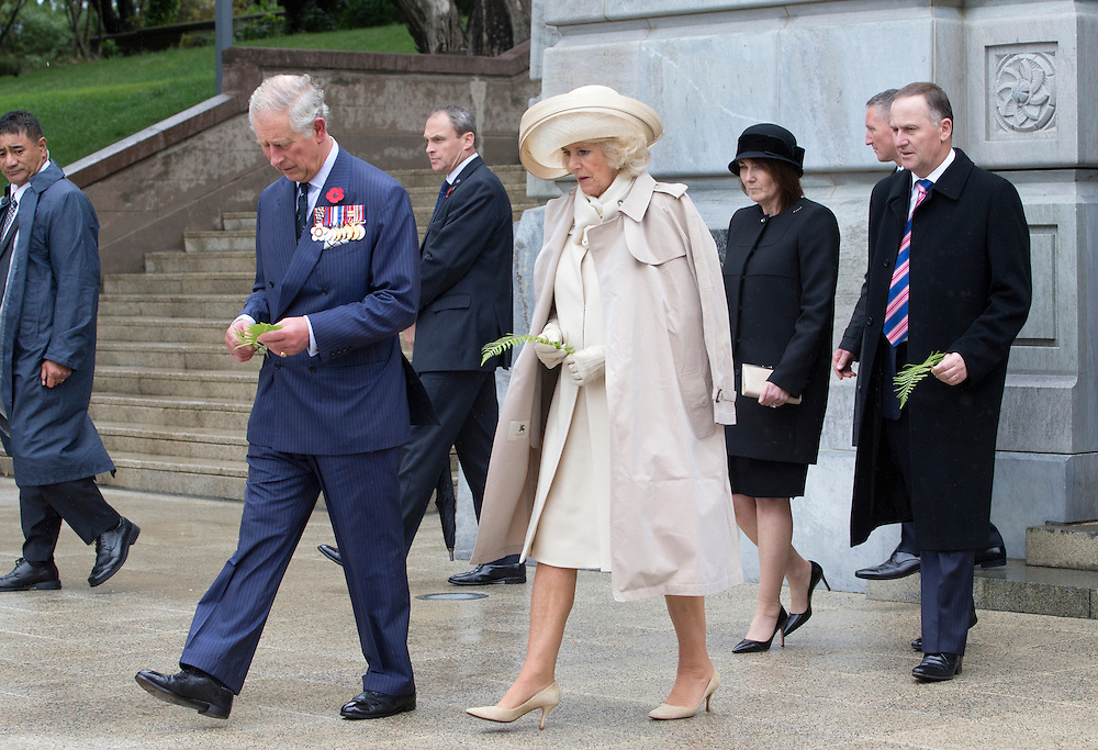 Prince Charles, Prince of Wales and Camilla, Duchess of Cornwall and New Zealand Prime Minister John Key, and his wife Bronagh, walking to lay ferns on the Tomb of the Unknown Warrior at the National War Memoriall, Wellington, New Zealand, Wednesday, November 04, 2015. Credit:SNPA / NZ Herald, Marl Mitchell **POOL**