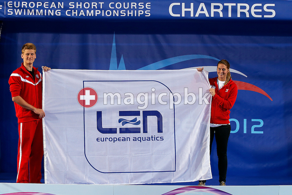 (L-R) Viktor B. BROMER, swimmer, and Caroline KLEEMANN, project leader Danish Swimming Federation, pose with the LEN flag during the 16th European Short Course Swimming Championships held at the aquatic complex L'Odyssee in Chartres, France, Sunday, Nov. 25, 2012. Denmark will host the next European Short Course Swimming Championships in the city of Herning(Photo by Patrick B. Kraemer / MAGICPBK)