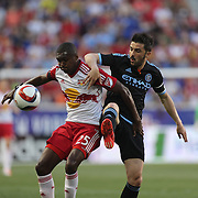 David Villa, (right), NYCFC, challenges Chris Duvall, New York Red Bulls during the New York Red Bulls Vs NYCFC, MLS regular season match at Red Bull Arena, Harrison, New Jersey. USA. 10th May 2015. Photo Tim Clayton
