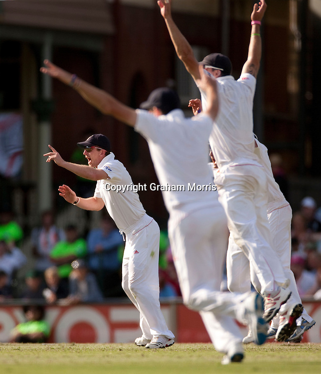 Paul Collingwood (left) leads the celebrations on the day he announces his retirement from Test cricket in the fifth and final Ashes test match between Australia and England at the SCG in Sydney, Australia. Photo: Graham Morris (Tel: +44(0)20 8969 4192 Email: sales@cricketpix.com) 06/01/11