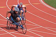 West Point, New York - Air Force athletes Mark Johnson, left, and Andrew Evans push through the turn in the wheelchair 200-meters in the 2014 Army Warrior Trials at the United States Military Academy Preparatory School on Tuesday, June 17, 2014.<br />