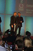 Chris Martin and Jonny Buckland.  The Q Awards, the  magazine's annual music awards,  Grosvenor House. October 10 2005. ONE TIME USE ONLY - DO NOT ARCHIVE © Copyright Photograph by Dafydd Jones 66 Stockwell Park Rd. London SW9 0DA Tel 020 7733 0108 www.dafjones.com