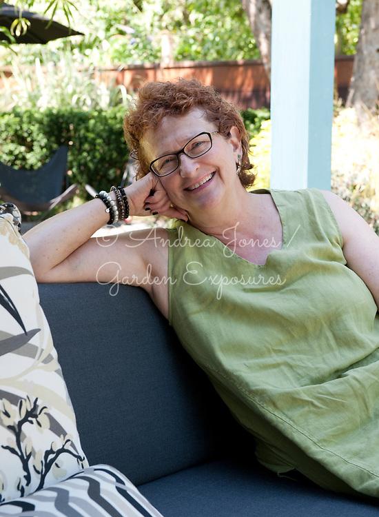 Gardener Nancy Goldman sitting outdoors in a garden, Portland, OR, USA