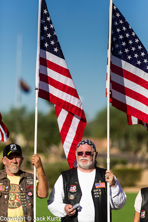 08 OCTOBER 2013 - PHOENIX, AZ: US military veterans hold American flags at a ceremony interring the cremated remains of unclaimed US military veterans at the National Memorial Cemetery in Phoenix. The cremated remains of 36 unclaimed US military veterans were interred at the National Memorial Cemetery in Phoenix. Members of the US military and several hundred veterans of the US military attended the service, which was a part of the Missing In America Project (MIAP).    PHOTO BY JACK KURTZ