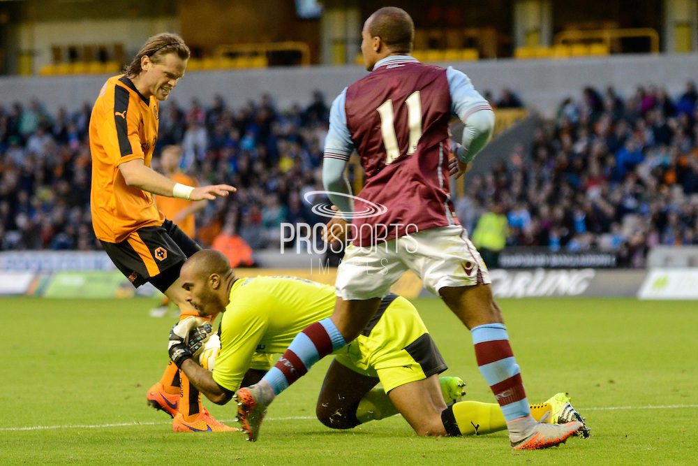 Carl Ikeme claims the ball ahead of Gabriel Agbonlahor during the Pre-Season Friendly match between Wolverhampton Wanderers and Aston Villa at Molineux, Wolverhampton, England on 28 July 2015. Photo by Alan Franklin.