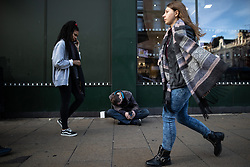 © Licensed to London News Pictures . 24/10/2018. Leeds , UK . A man , who appears to be suffering the effects of Spice , sits on the pavement outside a branch of McDonalds on Boar Lane in Leeds City Centre . At least six people sleeping rough have died in the Metropolitan Borough of the City of Leeds since March 2017 and West Yorkshire Police say they responded to 66 reported cases of people suffering the effects of Spice in July 2018 , a large increase on previous months . Photo credit : Joel Goodman/LNP