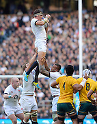 Twickenham, United Kingdom, Englands' Tom WOOD catch's a clean line out ball with support from left Joe LAUNCHBURY and right Courtney LAWES, during the 2013 QBE Autumn<br /> Rugby International, England vs Australia, played<br /> Saturday  02/11/2013.  RFU Stadium Twickenham,<br /> England. [Mandatory Credit: Peter Spurrier/Intersport<br /> Images]