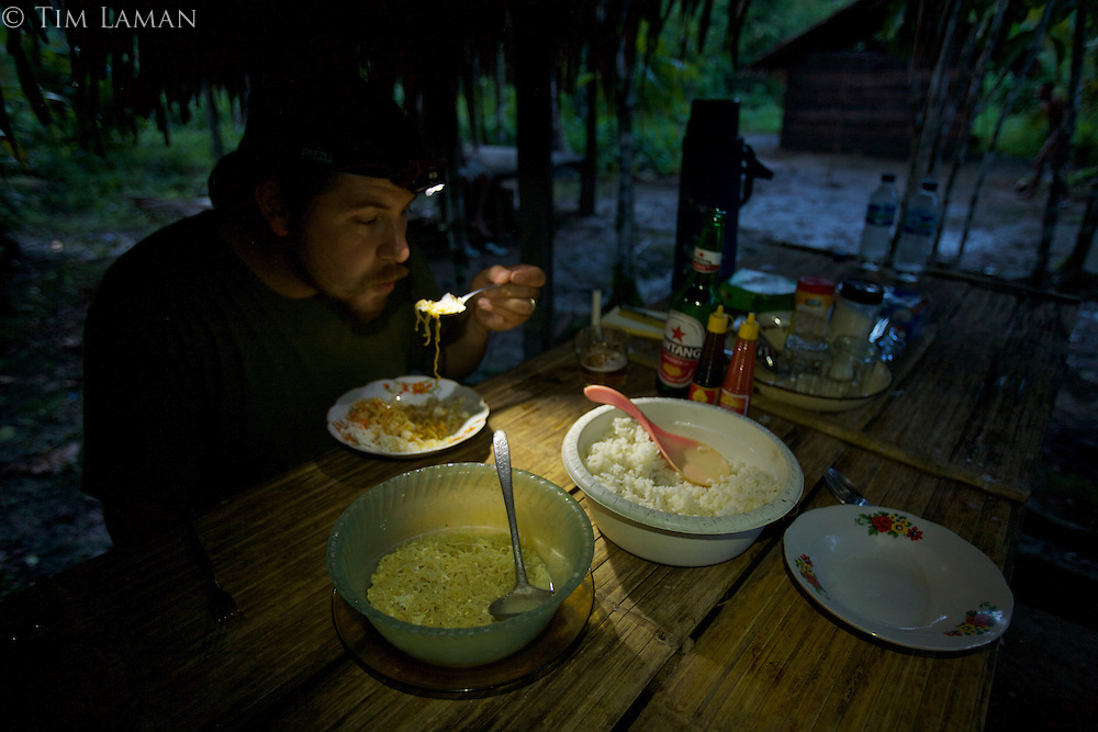 Edwin Scholes enjoys yet another meal of rice and instant noodles at our field camp at Labilabi, Halmahera.<br /> Alfred Russel Wallace spent a month at what was probably a similar field camp in Halmahera in 1858, when he wrote his famous essay on natural selection that he sent to Darwin.