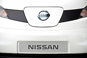 Photo shows the cover of the charging point located in the front of a prototype of Nissan's e-NV200 electric vehicle during a test run at the automaker's Oppama test circuit in Yokohama, Japan on 17 Oct. 2012.  Photographer: Robert Gilhooly