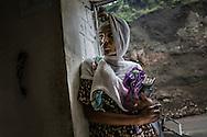 Woman lingers in a shop doorway in Lalibela, Ethiopia.
