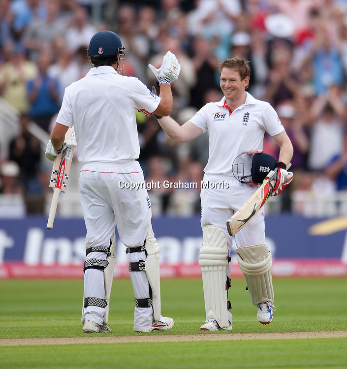 Eoin Morgan celebrates his century (with Alastair Cook, left) during the third npower Test Match between England and India at Edgbaston, Birmingham.  Photo: Graham Morris (Tel: +44(0)20 8969 4192 Email: sales@cricketpix.com) 12/08/11