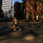 Runners head through there city centre in early morning light as they complete the ING Hartford Marathon, Bushnell Park, Hartford. Connecticut. USA. Hartford, Connecticut, USA. 12th October 2013. Photo Tim Clayton