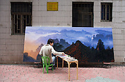 An artist paints a replica of a Chinese mountain scene in an artist village outside Shenzhen, March 31, 2006. China is creating a fast-growing army of trained artists to produce both copies and original works. Art has become such a popular major in China that the number of art graduates from universities soared 59 percent last year, to 20,031, according to China's education ministry.