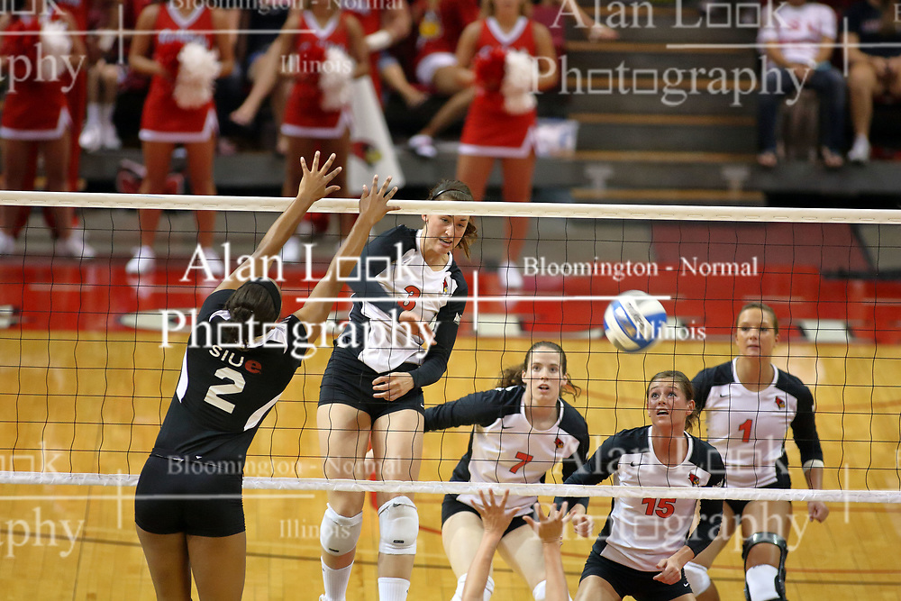 30 August 2011: Laura Wakefield, Kristin Stauter and Sierra Burris look on as Tabitha Visk strikes the ball past Cori Harris during an NCAA volleyball match between the Cougars of Southern Illinois Edwardsville and the Illinois State Redbirds at Redbird Arena in Normal Illinois.
