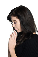 studio shot portrait on isolated white background of a Beautiful Woman profile praying prayer