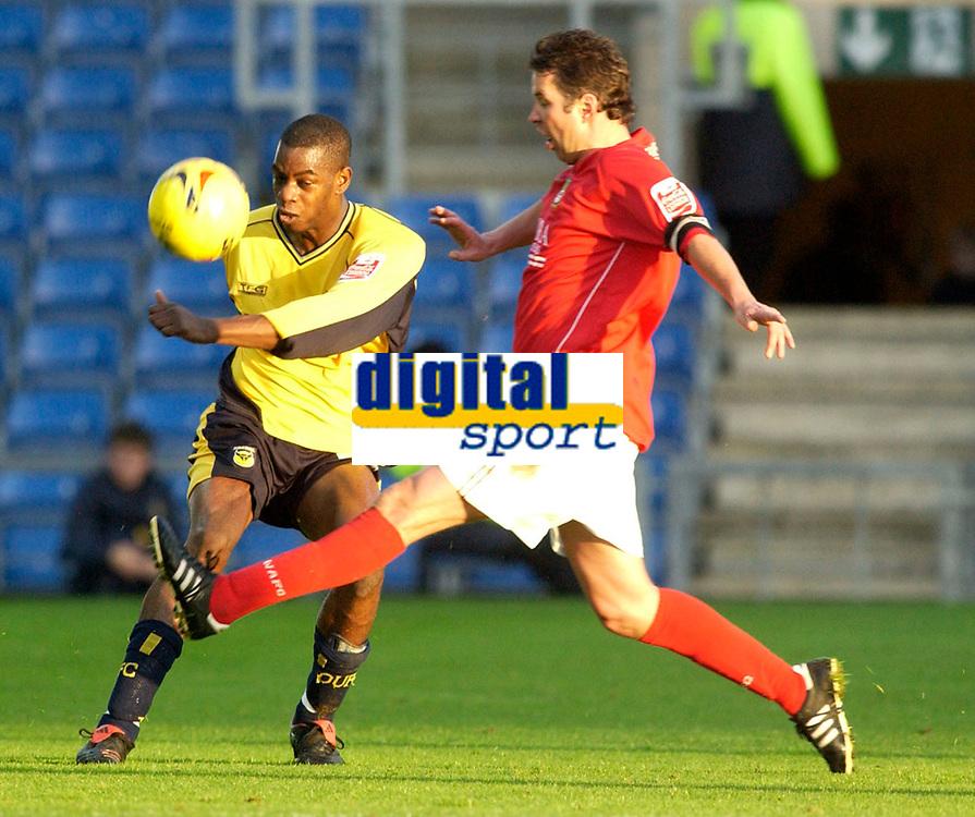 Photo: Daniel Hambury.<br />Oxford Utd v Wrexham. Coca Cola League 2.<br />12/11/2005.<br />Oxford's Leo Roget (L) clears from Wrexham's Darren Ferguson